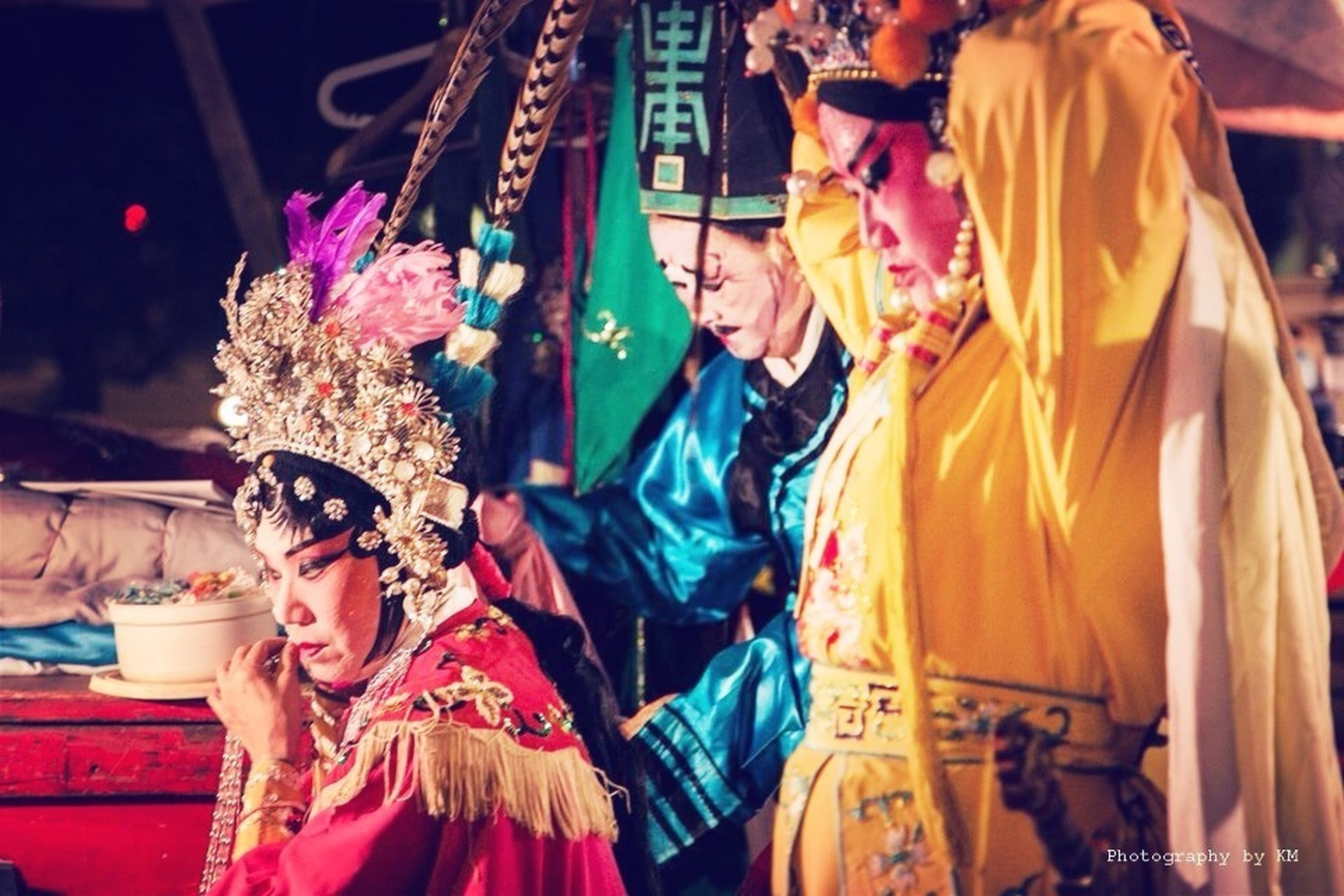 cultures, traditional clothing, men, tradition, clothing, multi colored, person, celebration, hanging, large group of people, art and craft, religion, arts culture and entertainment, outdoors, focus on foreground, flag, costume, creativity, art