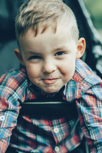 Cute little Boy making a face Boys Childhood Child Portrait Real People One Person Front View Headshot Cute Casual Clothing Blond Hair Lifestyles Close-up Innocence Making A Face Toddler  Expression Cheeky Sassy Rebellious 3 Years Old Kid Boy Males