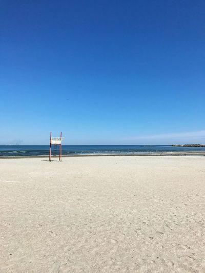 Lifeguard chair against sea at beach