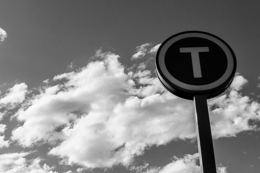 The train station sign Monochrome Black And White Light And Shadow Low Angle View Sky Cloud - Sky Communication Sign Nature No People Road Sign Day Road Outdoors Guidance Information Sign Information Pole Geometric Shape Symbol
