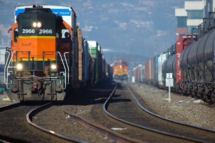 Freight trains in Seattle Washington Shipping Containers Train Tracks Choo Choo Fright Locomotive Orange Train Seattle Waterfront Train Train Cars Train Headlight