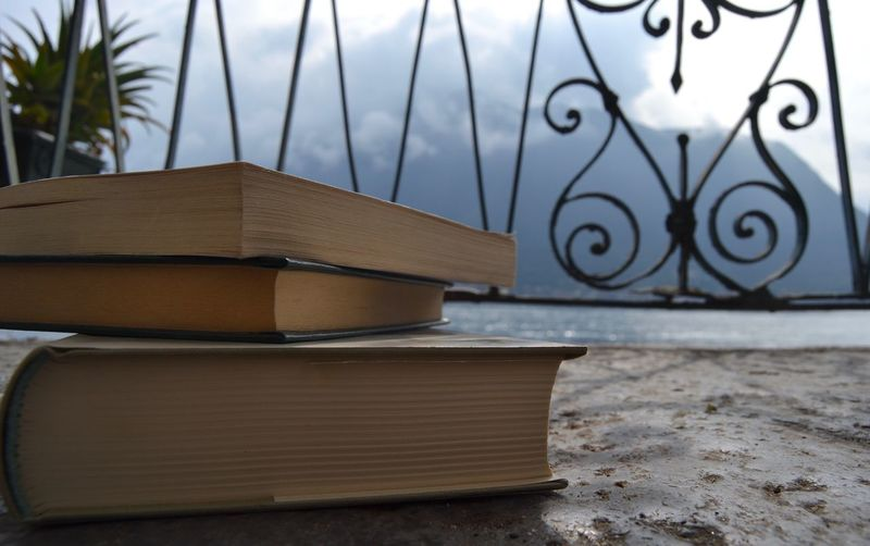 Books, Colonno, Como Lake Acqua Lago Nuvole Montagne Lettura Reading Libri  Water Cloud Cloud - Sky Mountain Lake View Como Lake Lake Books Book No People Publication Book Focus On Foreground Nature Sky Day Close-up Outdoors Built Structure