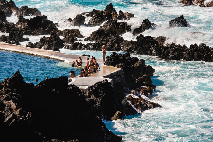 Natural swimming pool on Madeira Island Atlantic Ocean Madeira Island Beach Beauty In Nature Day Group Of People Holiday Land Leisure Activity Lifestyles Men Natural Pool Nature Outdoors People Pool Poolside Real People Rock Rock - Object Rock Formation Sea Solid Water Women