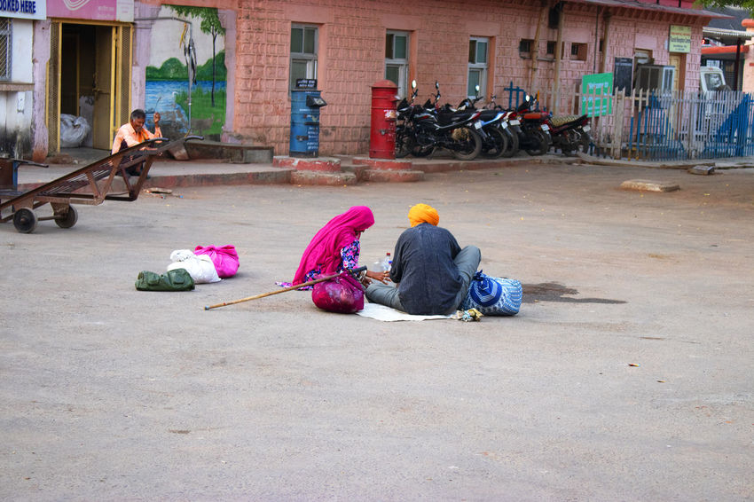 Locals living in outer yard of sawi Madhopur rail station India Railstation Building Exterior Group Of People Indoors  Lifestyles Outdoors Real People Sawi Madhopur Sitting Traditional Clothing Human Connection