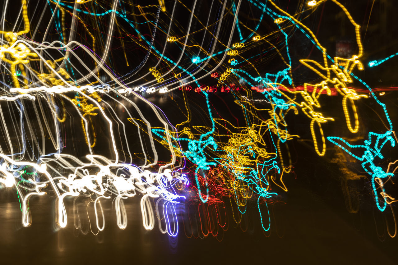 illuminated, multi colored, motion, night, glowing, light - natural phenomenon, pattern, long exposure, no people, lighting equipment, blurred motion, speed, abstract, decoration, complexity, light, light trail, electric light, celebration, close-up, black background