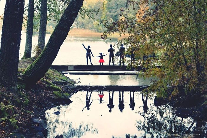 Black Stone People and one happy Girl with a red skirt Lake Lakeside Black People Hidden Hidden Places Red Skirt Stone Stone People Happy Girl  Wood Beatiful Nature Trip Walking By Walking By The River River Sweden Reflection Water Reflections Reflection Photography Scary Red Växjö
