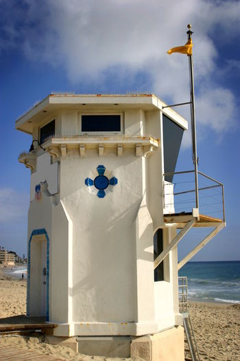 Lifeguard Tower Laguan Beach lifeguard tower with the ocean in the background. Architecture Cabin Coast Coastal Coastline Danger Dangerous Lifeguard  Observation Observe Outdoors Protection Recreation  Recreational  Sand Scene Season  Shore Sunny Sunshine Swimming Tourism Tourist Tower Wave