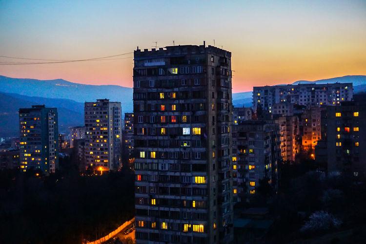 Illuminated city at sunset