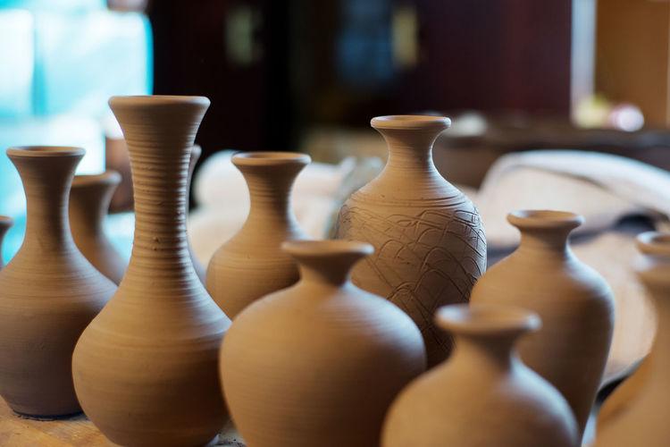Close-Up Of Pots At Workshop