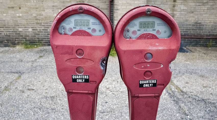 Parking Meters Twins City Parking Meter Parking Meters Close-up Communication Day No People Outdoors Pink Color Red Text