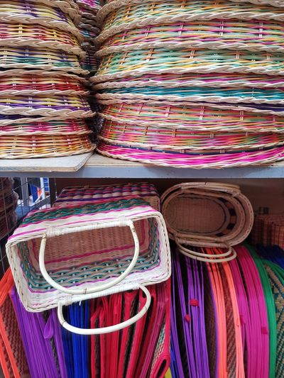 Stack of multi colored for sale at market stall