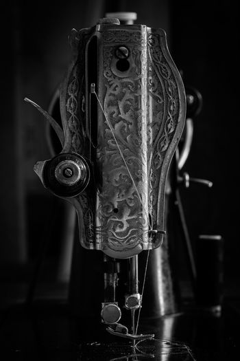 Close-up of sewing machine on table