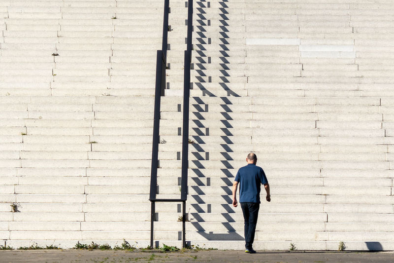 One Person Full Length Real People Lifestyles Standing Day Architecture Leisure Activity Casual Clothing Men Built Structure Building Exterior Young Adult Young Men Front View Sunlight Outdoors Steps And Staircases Steps Staircase Railing Shadow Sunlight And Shadow Redefining Menswear