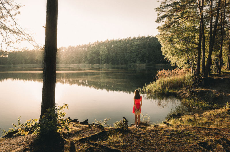 Magic moments Beauty In Nature Casual Clothing Childhood Clear Sky Day Full Length Grass Growth Lake Leisure Activity Lifestyles Nature One Person Outdoors People Real People Rear View Scenics Sky Standing Tranquil Scene Tranquility Tree Water Women Fresh On Market 2017