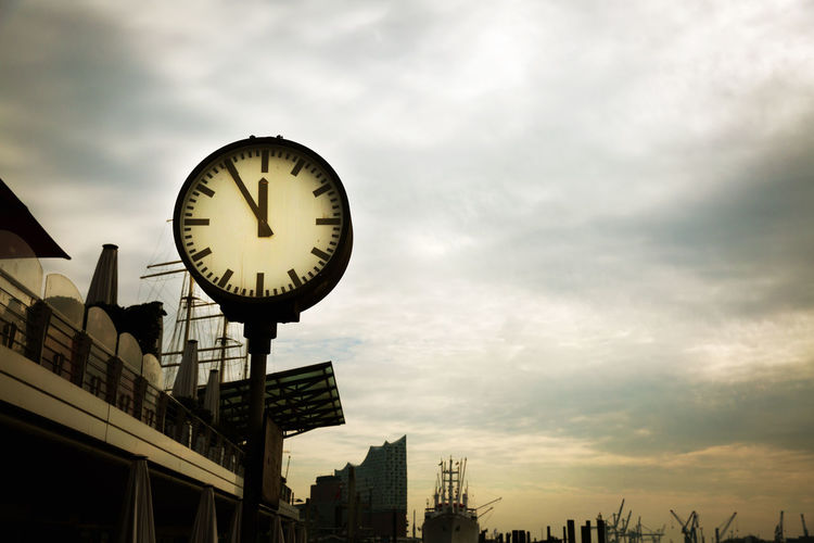 Sky Cloud - Sky Low Angle View Architecture Clock Time Built Structure Sunset No People Building Exterior Outdoors City Dusk Illuminated Building Circle Clock Face Minute Hand 5to12 Deadline Hurry Up Dramatic Lighting