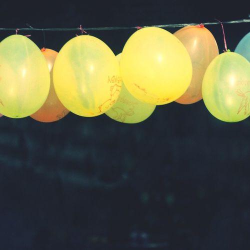 Close-up of yellow balloons hanging