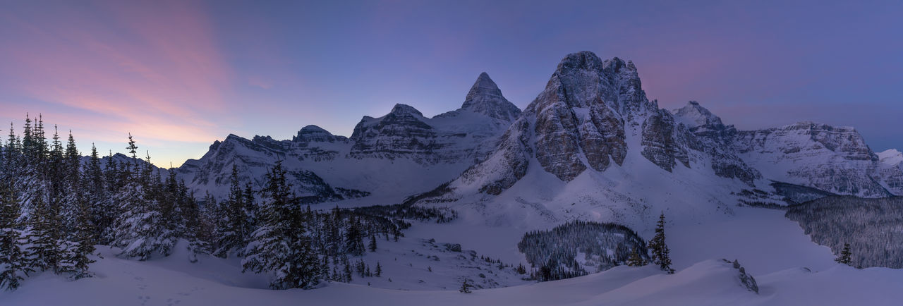 Mount Assiniboine national park pano at sunrise. This place is almost inaccessible this time of the year. You have to fly to the hut area via helicopter. Then from the hut it takes us about 2 days to break trail through knee deep snows to get up to this location Mount Assiniboine Assignments Canada Canadian Rockies  Panorama Sunrise Sunset Mountain Day No People Nature Snow Winter Winter Wonderland Winter Trees Alberta British Columbia Snowcapped Mountain Beauty In Nature Clouds Extreme Weather Assiniboine Park Sunburst