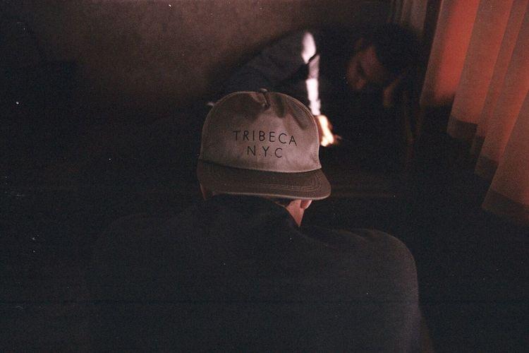 Lit man in dark room