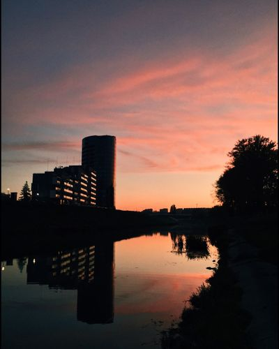 Sunset Reflection Built Structure Silhouette Architecture Building Exterior Sky Water Tree Skyscraper No People Waterfront City Outdoors Travel Destinations Beauty In Nature Modern Nature Day EyeEm Gallery Streetphotography Eye4photography  EyeEm Best Edit OpenEdit EyeEm Best Shots