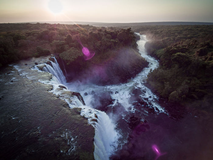 Scenic view of lumangwe falls against sky during sunset, zambia