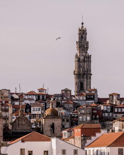 Buildings against clear sky in city