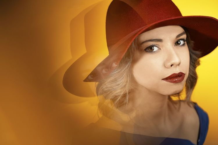 Digital Composite Image Of Young Woman Wearing Hat Against Yellow Background