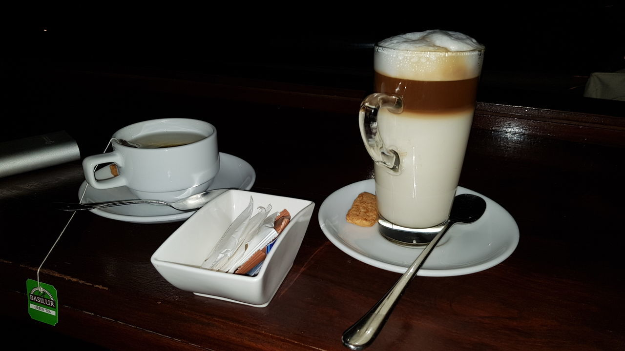 CUP OF COFFEE ON TABLE AT HOME