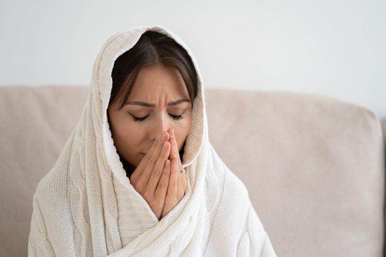 Close-up of depressed woman praying at home