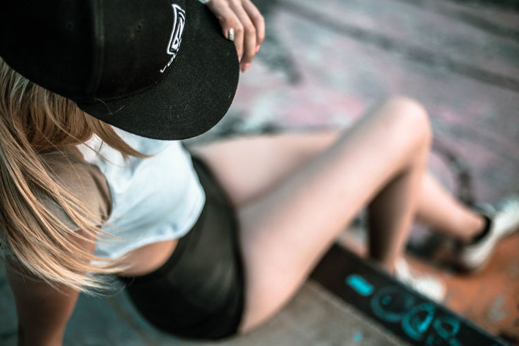 EyeEmNewHere Skatepark Blond Hair Cap Close-up Day Fashionable Healthy Lifestyle High Angle View Lifestyles One Person Real People Skater Urban Clothing