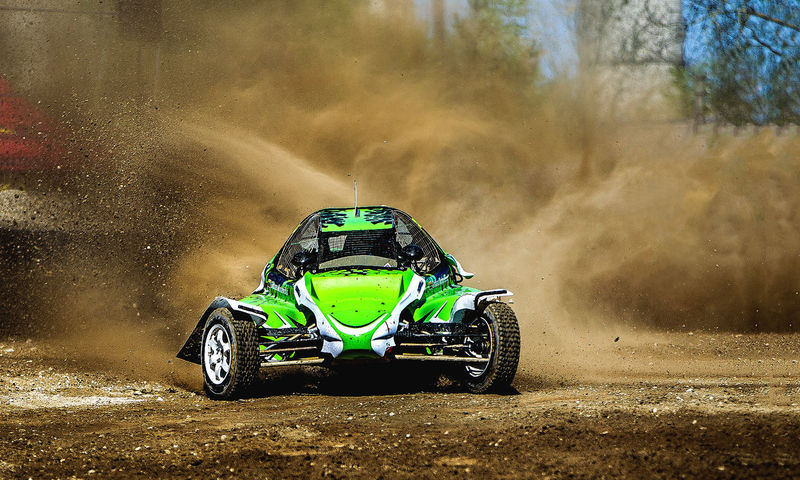 Action Buggy Car Cloud - Sky Day Dust Dusty Track Green Color Land Vehicle Mode Of Transport Motorsport Mud Nature No People Off-road Vehicle Outdoors Sand Sports Race Transportation