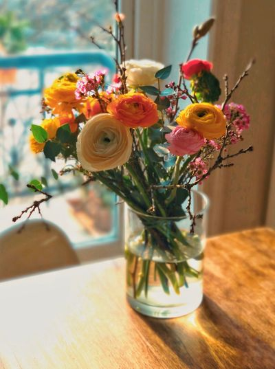 Flowers in a vase Vase Flower Flowering Plant Plant Table Decoration Indoors  Flower Arrangement