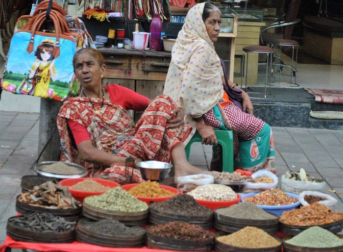 Women selling spices on the busy streets of Charminar, Hyderabad Charminar Charminar Area Charminar The Pride Of Hyderabad Busy Street Street Vendor Women Around The World Women Working Women Spices Street Scenes Road Side Vendor Mix Yourself A Good Time