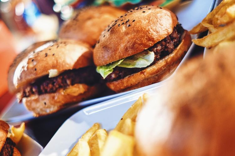 High angle view of burgers served in tray on table