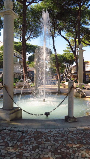 Italy Milano Marittima Vacations Travel Travel Destinations Traveling Travel Photography Tree Architecture Fountain Water Spraying Motion Plant Nature Day Splashing Built Structure Outdoors Park No People Park - Man Made Space Long Exposure Footpath Tree Trunk Trunk Flowing Water Flowing