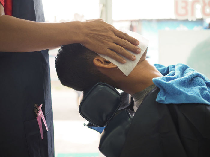 Close-Up Of Man Getting Massage