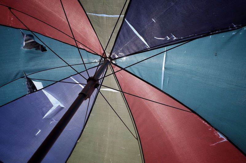 Full frame shot of torn colorful umbrella