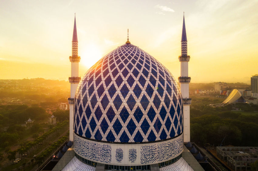Sunrise at a mosque, Aerial View. Aerial Photography Aerial Shot Aerial View Allah Architecture ASIA Building Exterior City Cityscape Culture Day Dome High Angle View House Of Worship Islam Islamic Architecture Malaysia Minaret Mosque No People Outdoors Sky Skyscraper Sunrise Sunset