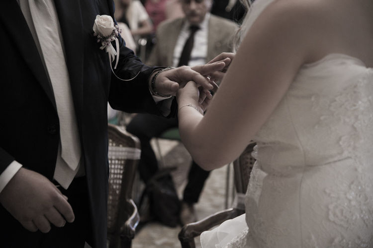 Wedding hands of a bride and groom Midsection Group Of People Event Celebration Wedding Men Women People Hand Adult Real People Life Events Incidental People Human Hand Bride Focus On Foreground Togetherness Indoors  Standing