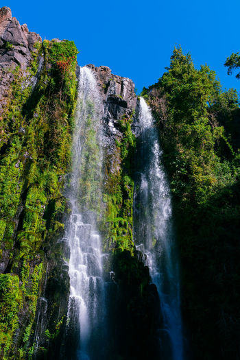 Beauty In Nature Cliff Falling Water Flowing Flowing Water Land Long Exposure Low Angle View Motion Nature No People Non-urban Scene Outdoors Power In Nature Rock Rock - Object Rock Formation Scenics - Nature Solid Travel Destinations Tree Water Waterfall