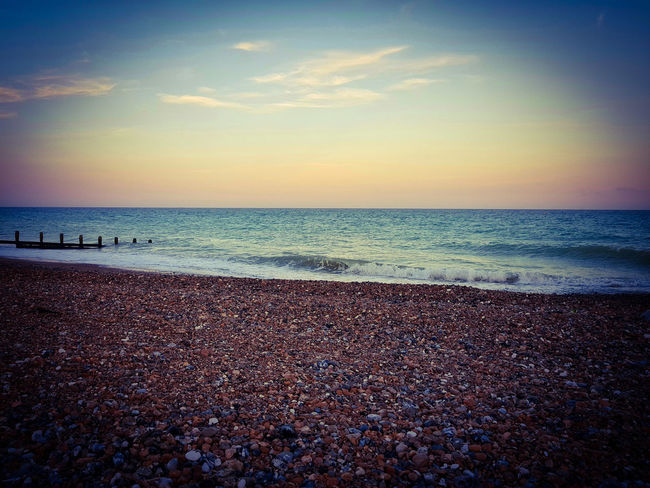 Sea Beach Horizon Over Water Water Nature Sky Tranquility Shore Beauty In Nature Tranquil Scene Summer Outdoors Sunset Pebble No People Lancing  Clouds
