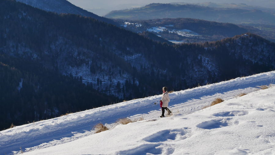 Woman on snowcapped mountains