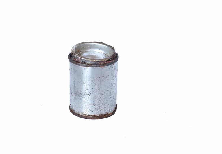 High angle view of metallic container against white background