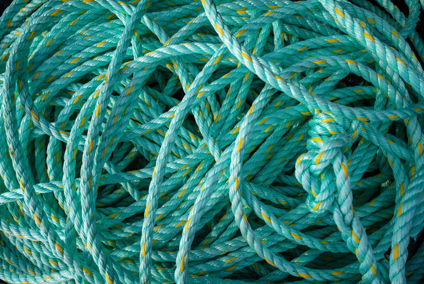 Partner Collection The EyeEm Collection Green Rope Backgrounds Blue Close-up Complexity Connection Day Fishing Industry Full Frame Green Color High Angle View No People Pattern Repetition Rope Ropes Still Life String Tangled Textile Textured  Thread Turquoise Colored Wool Rope Textured  Green Color