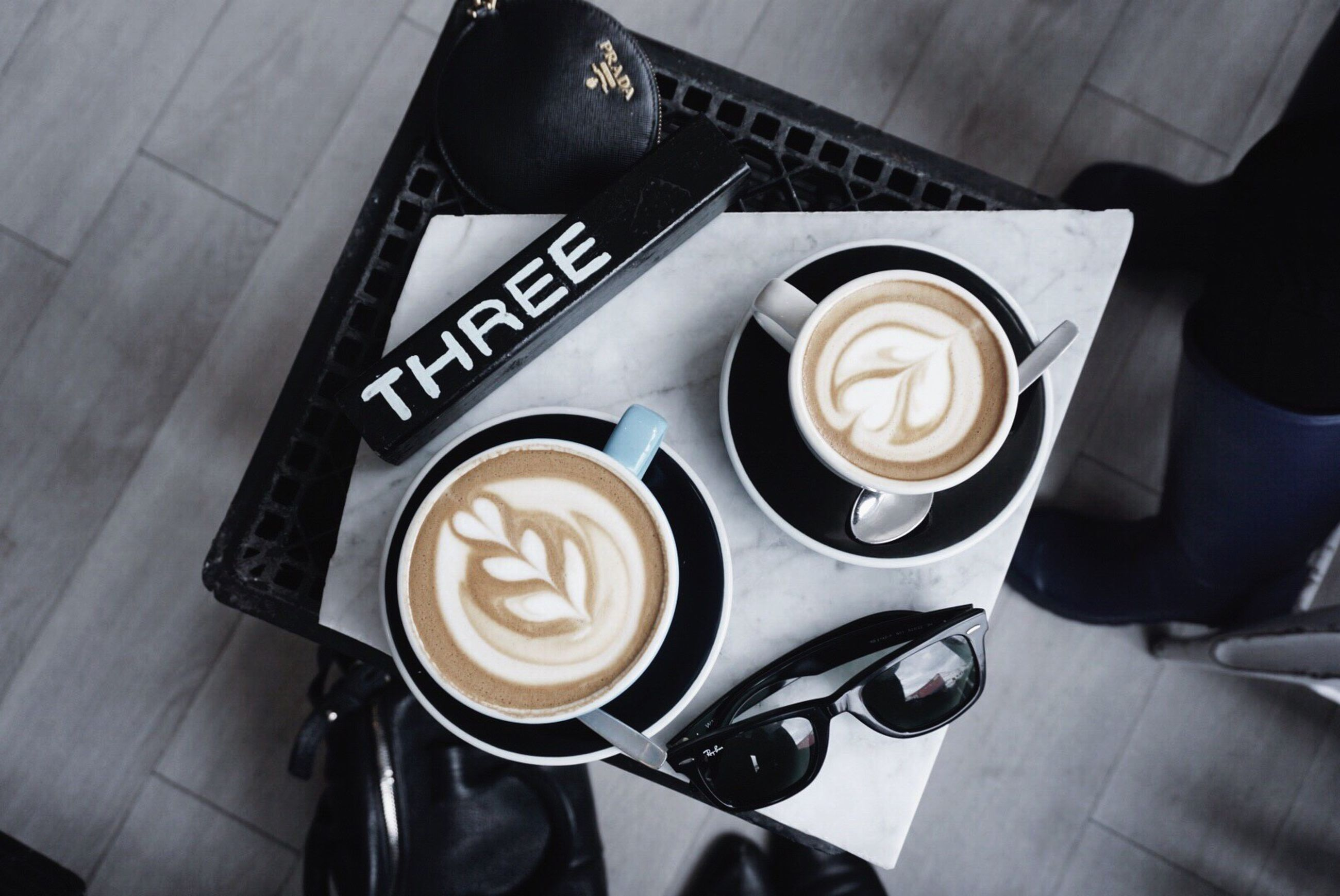 coffee - drink, coffee cup, cappuccino, drink, high angle view, froth art, frothy drink, food and drink, latte, refreshment, lifestyles, table, espresso, tuxedo, coffee break, leisure activity, indoors, close-up, mocha, no people, day