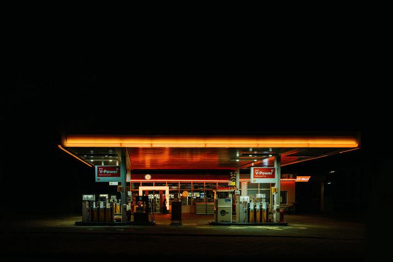 View of illuminated store at night