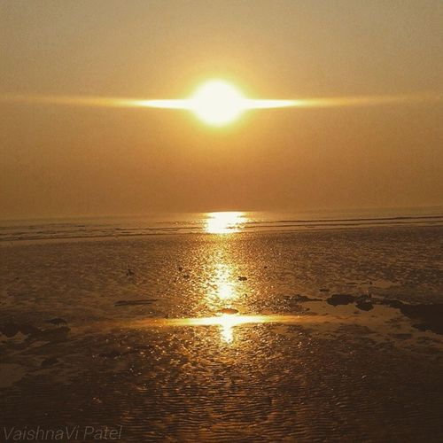 Sunsets, like childhood, are viewed with wonder not just because they are beautiful but because they are fleeting... Nature_and_sunsets Photographyshoutout3 Instamumbai Selfclicked fun 1000thingstodoinmumbai camera_incentives 1000thingstodoinindia bns_seabeach fromwhereistand lifeinaline incrediblemumbai mumbai InstaMumbai with_mumbai juhubeach beach sea lowtide calm water bns_sunset happy