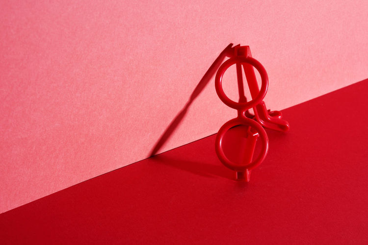 Close-up of red umbrella on wall