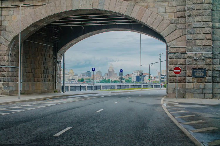 Road by bridge in city