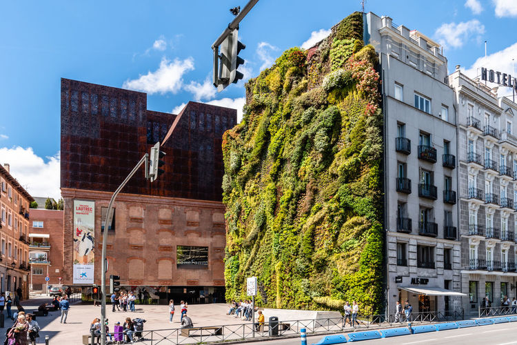 Architecture Group Of People Built Structure Real People Men Building Exterior Crowd Day City Lifestyles Building Outdoors City Cityscape Madrid Travel Destinations Europe European  Sighseeing Tourism Vertical Garden Caixa Caixaforum Herzog&deMeuron Modern Architecture Museum