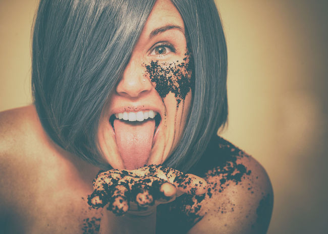 Adult Awake Blue Hair Caffeine Cheerful Coffee Coffee Grounds Female Funny Headshot Humor Lick Lively Looking At Camera Looking At Camera One Person One Woman Only Perky Portrait Taste Tongue Wake Up Whimsical Woman Young Adult